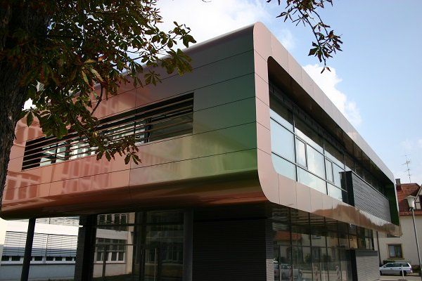 husk architectural partnership with alucobond aluminium composite material panels