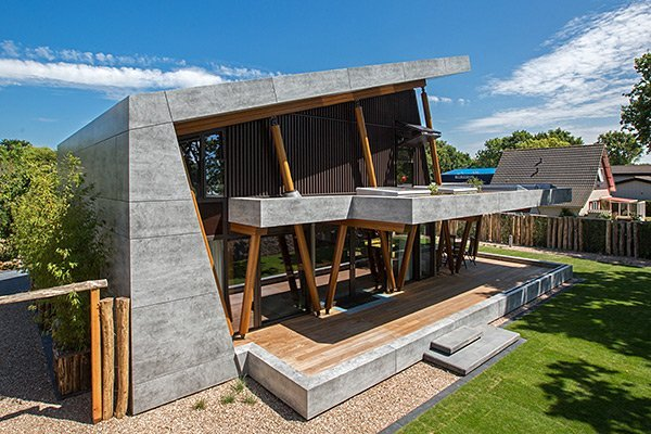 husk architectural alucobond holiday home with vintage concrete effect facade panels
