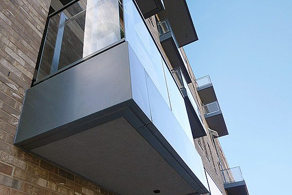 husk architectural aluminium balcony fascias and cills for new union wharf