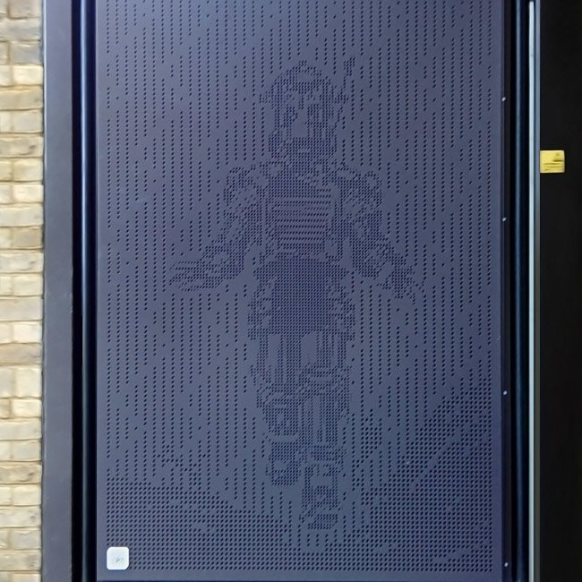 Specialist aluminium fabrication: Tobor the Great character punched into an aluminium gate